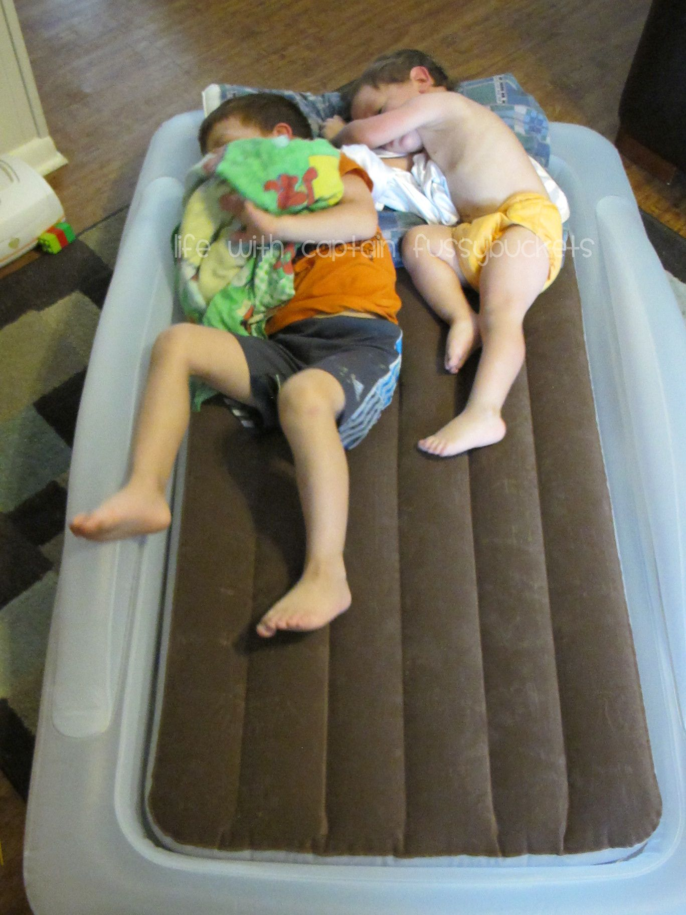 Holiday Traveling is Made Easy with The Shrunks Toddler Travel Bed