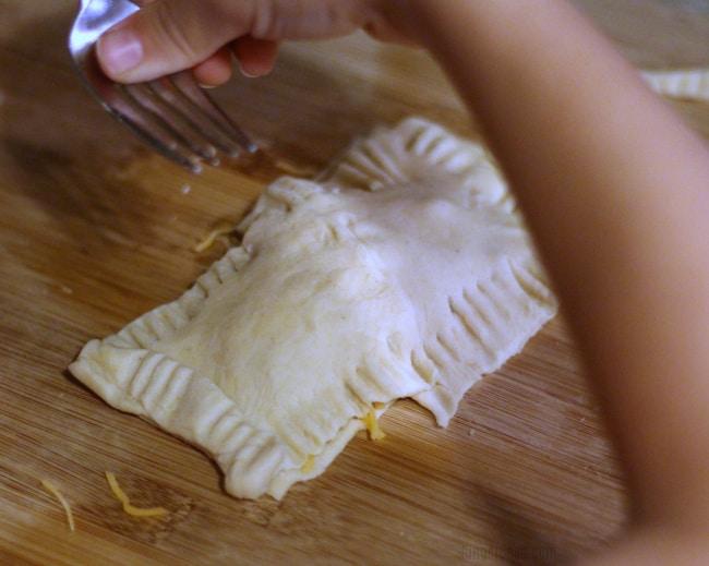 child making air fryer breakfast pockets