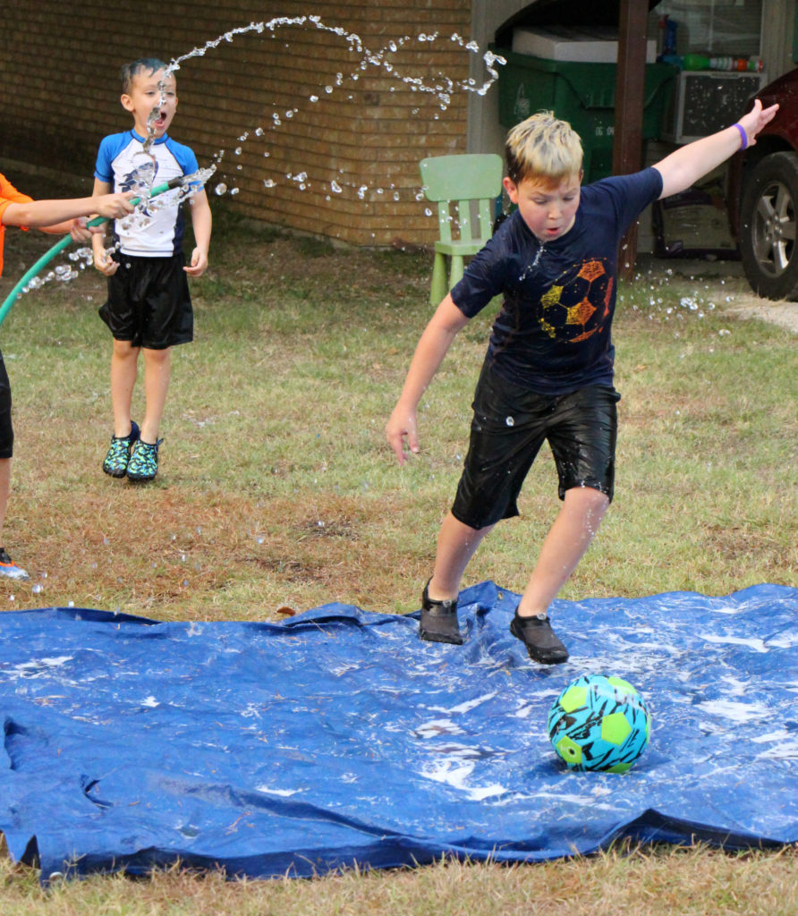Awesome Ideas to do with the Kids on Your Family Camping Trip water soccer goliath ball
