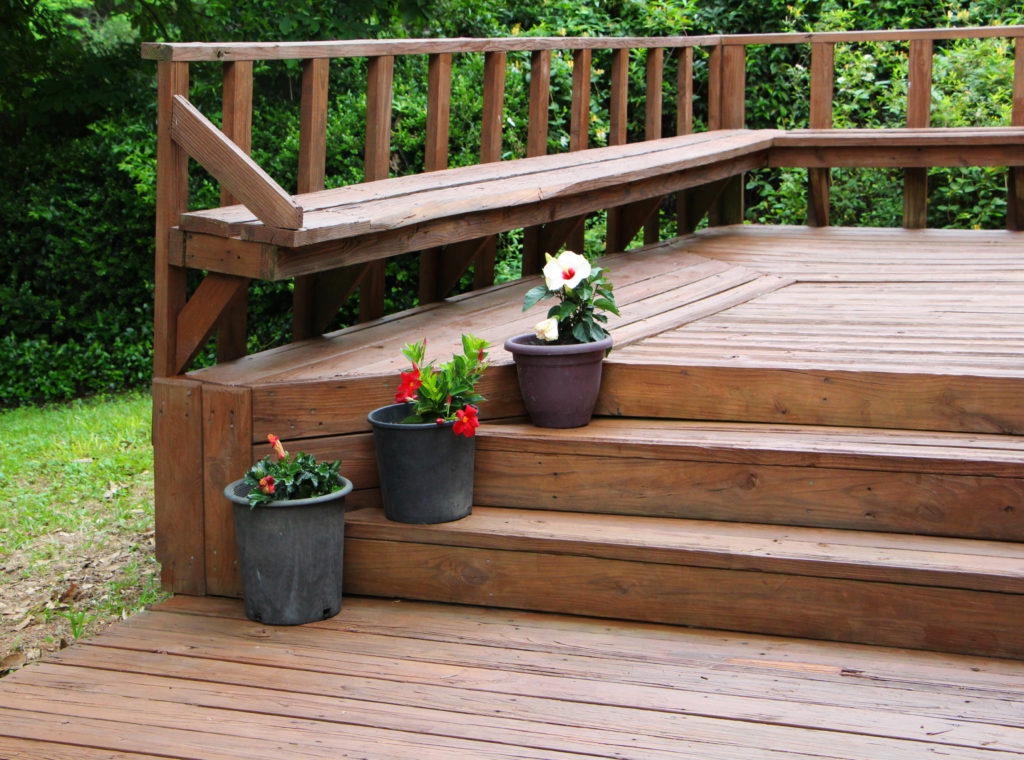 deck with flowers - pollinator friendly yard